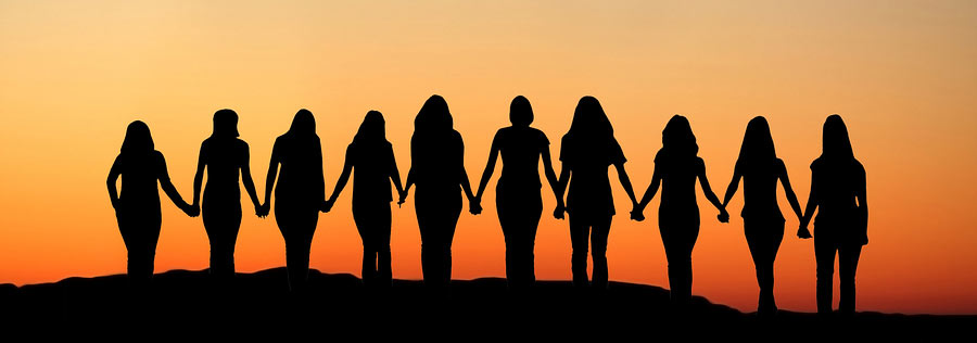 Women-holding-hands-Sunrise-silhouette